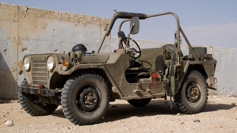 Military jeeps and other vehicle props.